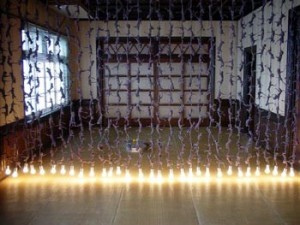 "Kyotaro Hakamata, ""Blood Relative Curtain"" 2003, installation in tatami room, electrical wire, light bulbs"