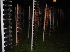 "Masao Koizumi and Tokyo Metropolitan University Koizumi Seminar, ""A Piece of Land—Bright and Empty"" 2003, installation in vacant lot, plastic drink bottles, electric lights, cellular phones"