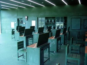"Tastuo Kawaguchi, ""Relation-Blackboard Classroom/Relation Farmer's Work"" 2003, installation, desks, computers, mixed media"
