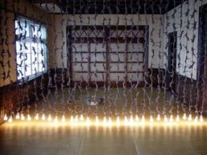 "Kyotaro Hakamata, ""Blood Relative Curtain"" 2003, installation in tatami room, electrical wire, light bulbs"